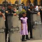 Stock Photo of a young girl surrounded by riot police